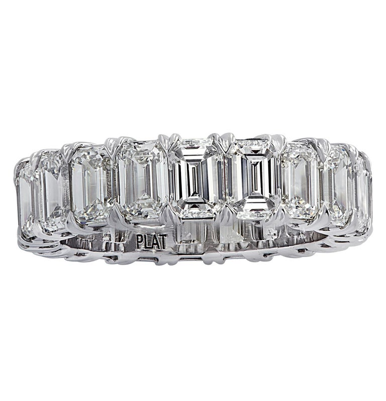Exquisite Vivid Diamonds eternity band crafted by hand in Platinum, showcasing 20 stunning emerald cut diamonds weighing 6.35 carats total, F-G color, VS clarity. Each diamond is carefully selected, perfectly matched and set in a seamless sea of