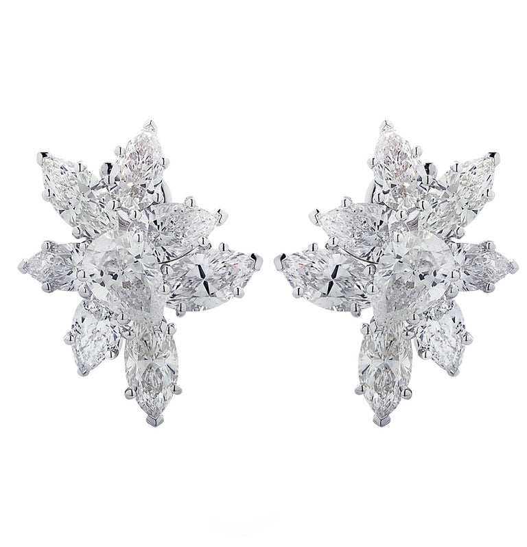 Sensational Vivid Diamonds earrings, custom made in platinum, showcasing 16 pear shape and marquise cut diamonds weighing 7.92 carats total, G-H color SI clarity. The diamonds are arranged in spectacular flowers, capturing the unparalleled beauty of