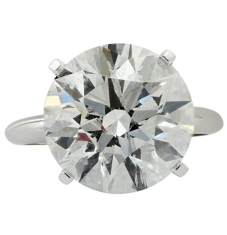 Sensational Vivid Diamonds solitaire engagement ring crafted in 18 karat white gold, showcasing a spectacular round brilliant cut diamond weighing 8.01 carats, I color, SI3 clarity. This exquisite diamond needs no adornments as it holds the
