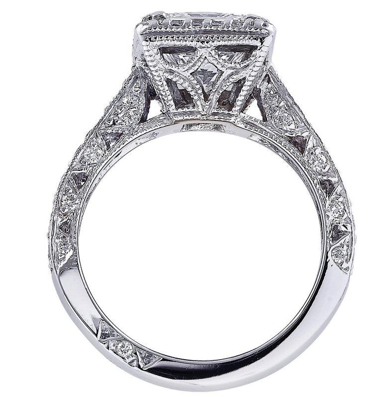 Sensational Vivid Diamonds halo engagement ring crafted in platinum showcasing an exquisite GIA Certified Princess Cut diamond weighing 2.04 carats, H color, VS1 clarity (GIA report # 15199124). The halo and band of this spectacular ring are adorned