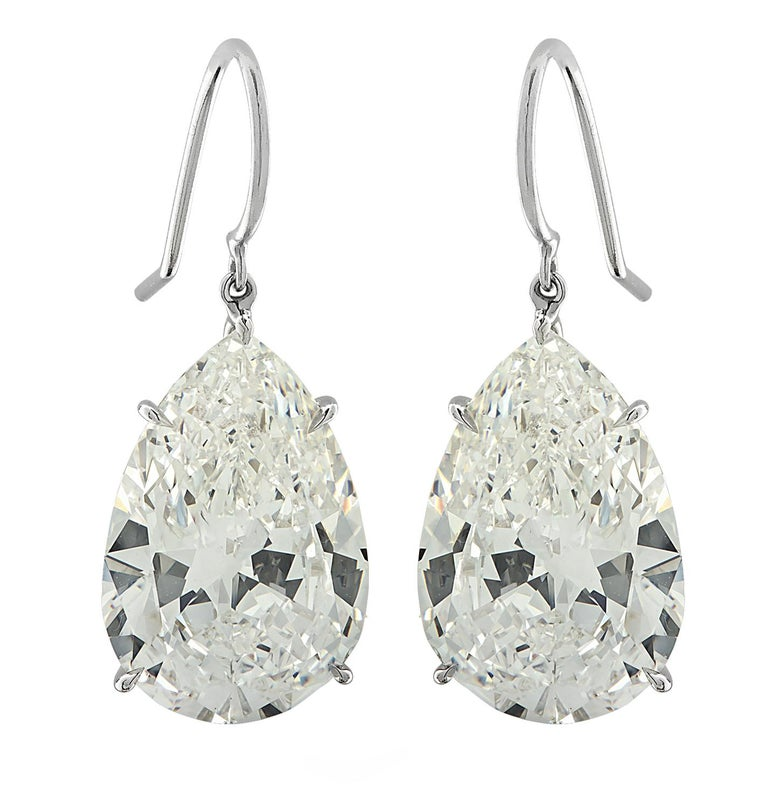 Exquisite Vivid Diamonds Dangle Earrings crafted in Platinum showcasing two sensational GIA graded pear shape diamonds weighing 20.48 carats total, I-J color, VS2-SI1 clarity. The diamonds were carefully selected, perfectly matched and set to dance