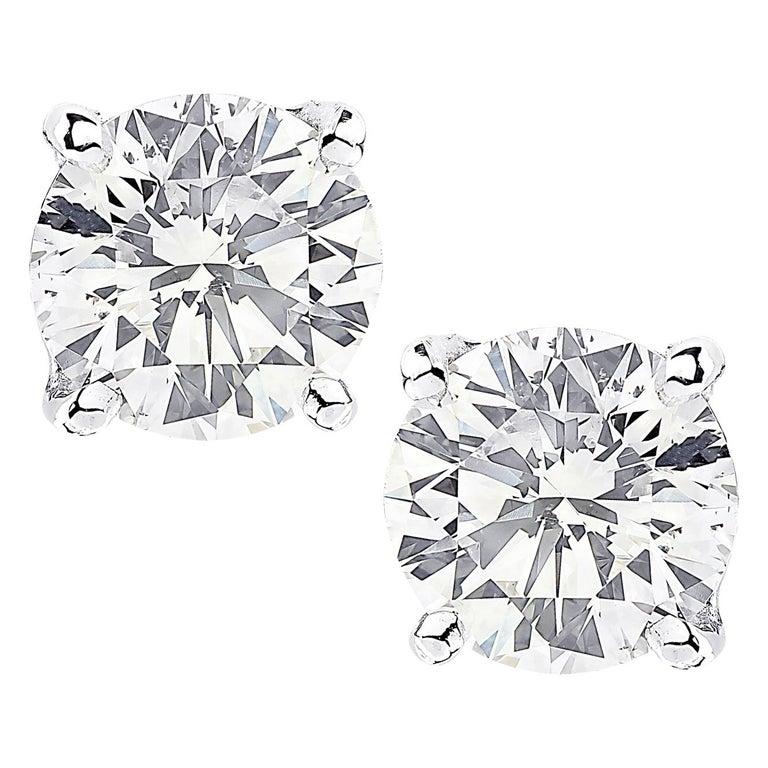 Vivid Diamonds GIA Certified 2.06 Carat Diamond Stud Earrings For Sale