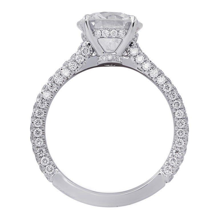 Spectacular Vivid Diamonds engagement ring finely crafted in platinum showcasing a stunning GIA certified round brilliant cut diamond weighing 2.09 carats, G color, SI2 clarity. The band and basket of this sensational ring are encrusted with 116