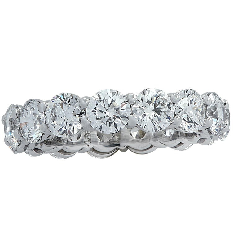 Exquisite eternity band crafted in Platinum, showcasing 15 stunning GIA certified round brilliant cut diamonds weighing 4.68 carats total, D color, VS-SI clarity. Each diamond was carefully selected, perfectly matched and set in a seamless sea of