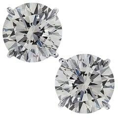 Vivid Diamonds GIA Certified 7.01 Carat Diamond Solitaire Stud Earrings