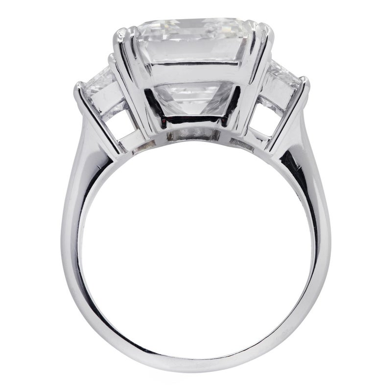 Exquisite Vivid Diamonds engagement ring crafted in platinum, featuring a spectacular GIA certified emerald cut diamond weighing 8.57 carats, H color, VS1 clarity,  adorned with two carefully selected and perfectly matched trapezoid diamonds