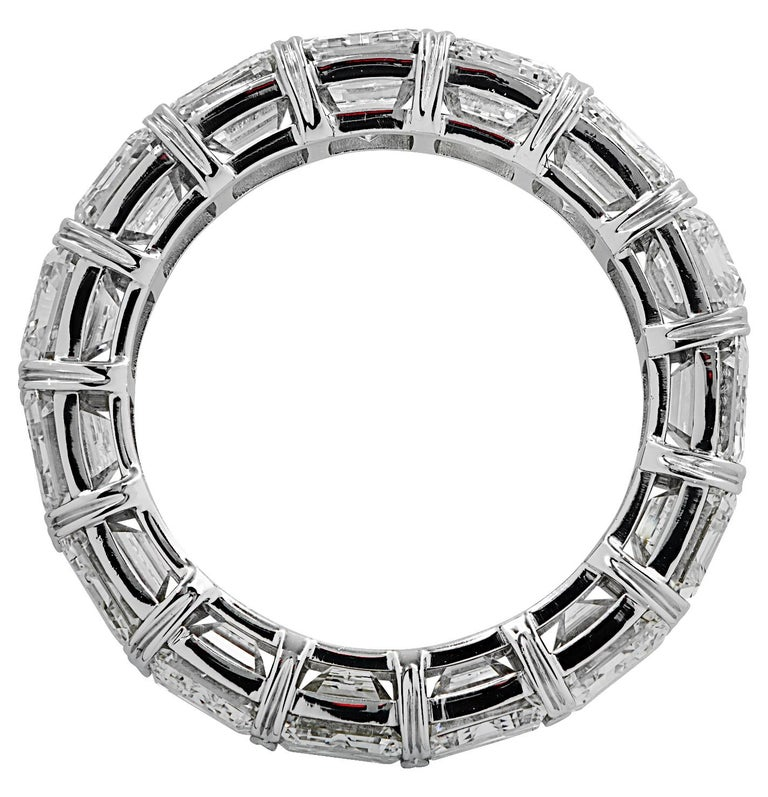 Exquisite eternity band crafted in Platinum, showcasing 17 stunning GIA Certified emerald cut diamonds weighing 9.03 carats total, D-F color, IF-VS clarity. Each diamond was carefully selected, perfectly matched and set in a seamless sea of