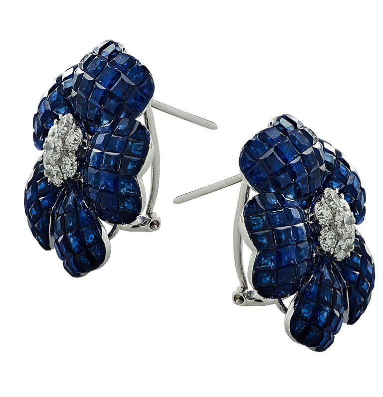 Enchanting Sapphire and Diamond Stud Earrings crafted in 18 karat white gold, featuring square cut Sapphires weighing approximately 37.85 carats total, and round brilliant cut diamonds weigh approximately 1.10 carats total, G color, VS clarity.