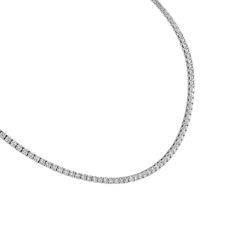Exquisite Vivid Diamonds Straight Line diamond necklace crafted in 18 karat white gold, showcasing 140 round brilliant cut diamonds weighing 11.47 carats total, F-G color, VS Clarity. The diamonds are set in a seamless sea of eternity, creating a