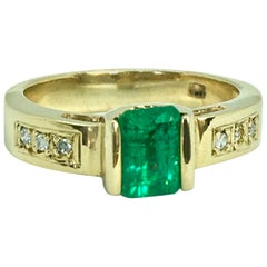 Vivid Emerald Solitaire Ring 18 Karat Yellow Gold