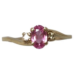 Vivid Pink Sapphire & Diamond Three-Stone Ring 0.60tcw 14 Karat Yellow Gold Oval