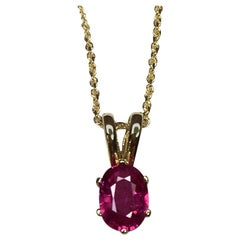 Vivid Pinkish Red 0.54 Carat Ruby Solitaire Oval Cut Yellow Gold Pendant
