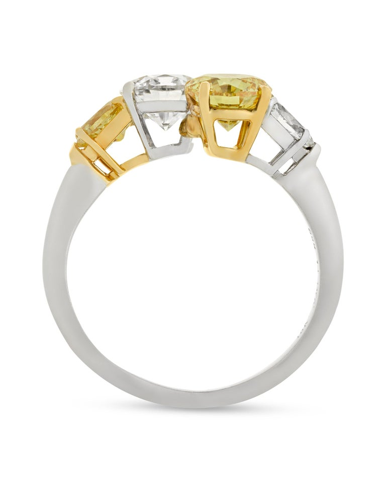 A rare internally flawless white diamond intersects with a natural fancy vivid yellow diamond in this classic bypass ring. Both stones are certified by the Gemological Institute of America (GIA): the 1.01-carat white diamond is classified to be