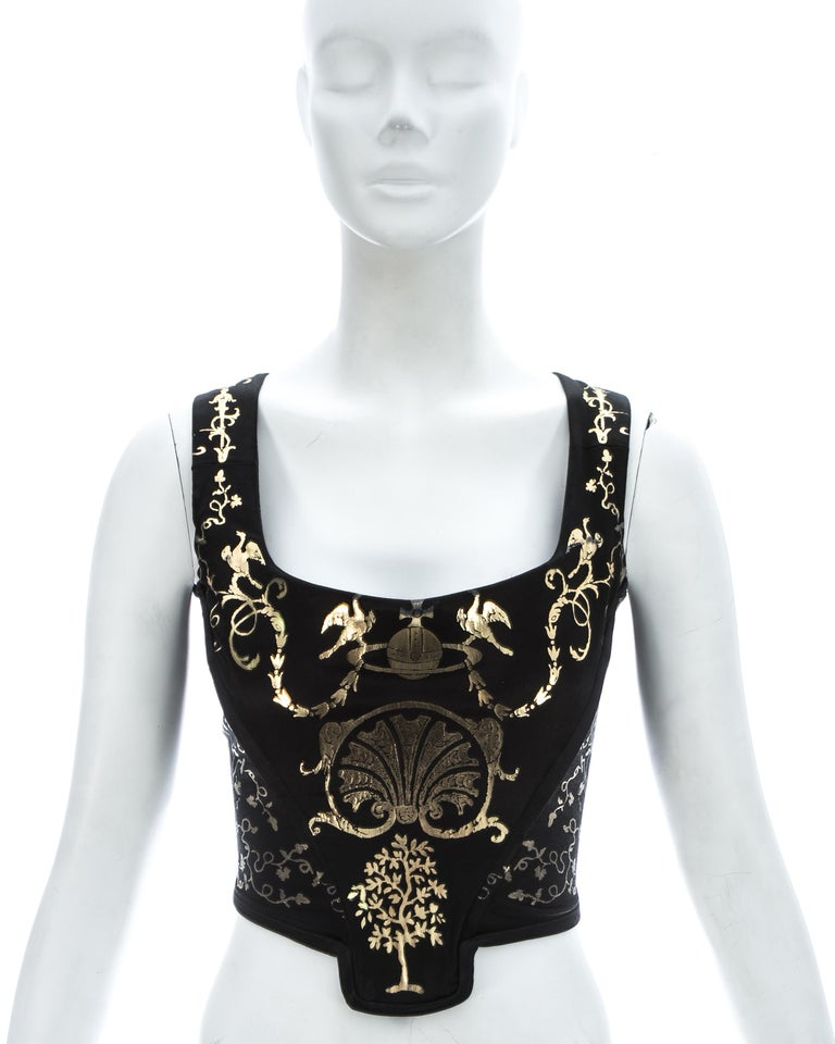 Vivienne Westwood black satin corset with metallic gold applied decoration of classical figures and motifs, and internal boning; designed to chinch the waist and push the breasts up.   'Portrait Collection' Fall-Winter 1990