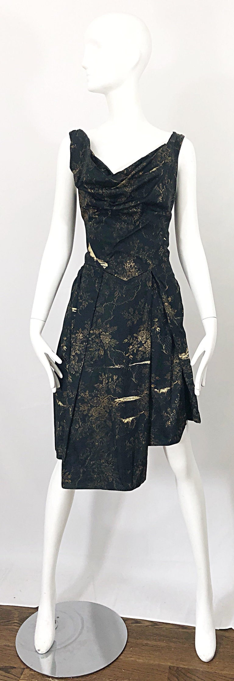 Avant Garde early 2000s  VIVENNE WESTWOOD black and brown flower print asymmetrical dress! Features Westwood's signature draped bodice. Hi-Lo skirt. Hidden zipper up the back with hook-and-eye closure. POCKET at one side of the hip.  Can also be