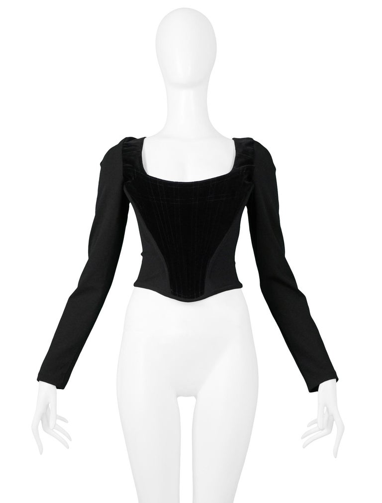 2005b209686 Vintage Vivienne Westwood black velvet   wool long sleeve corset featuring  a back zipper closure and