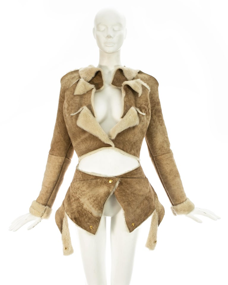 Vivienne Westwood; cream shearling sheepskin deconstructed jacket with raw edges and gold snap buttons closures throughout. Can be styled in multiple ways.   Fall-Winter 1999