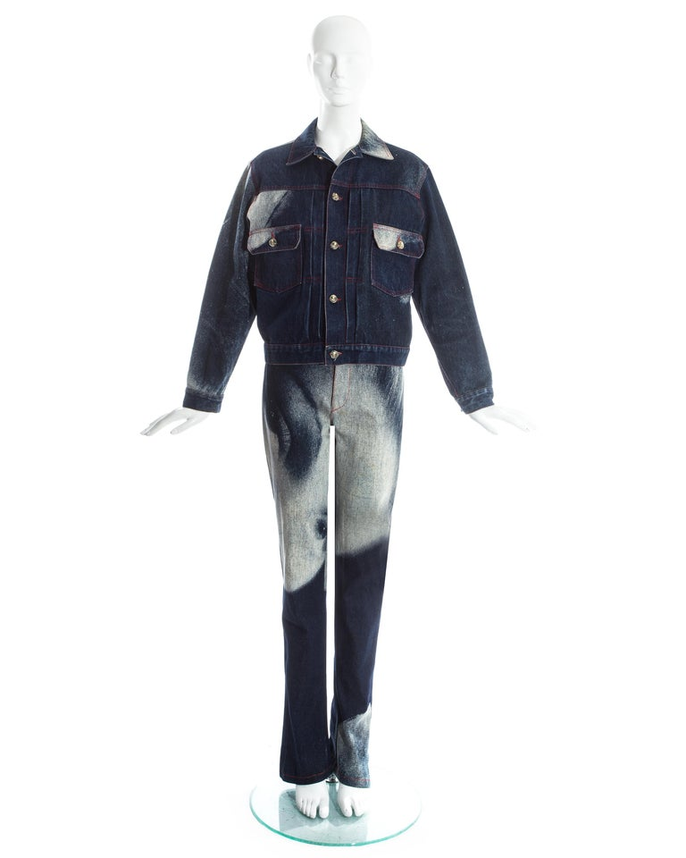 Vivienne Westwood denim pant suit printed with the iconic Marlene Dietrich print. Slim fit and high waisted jeans. Button up denim jacket.    'Always on Camera' pant suit, Fall-Winter 1992