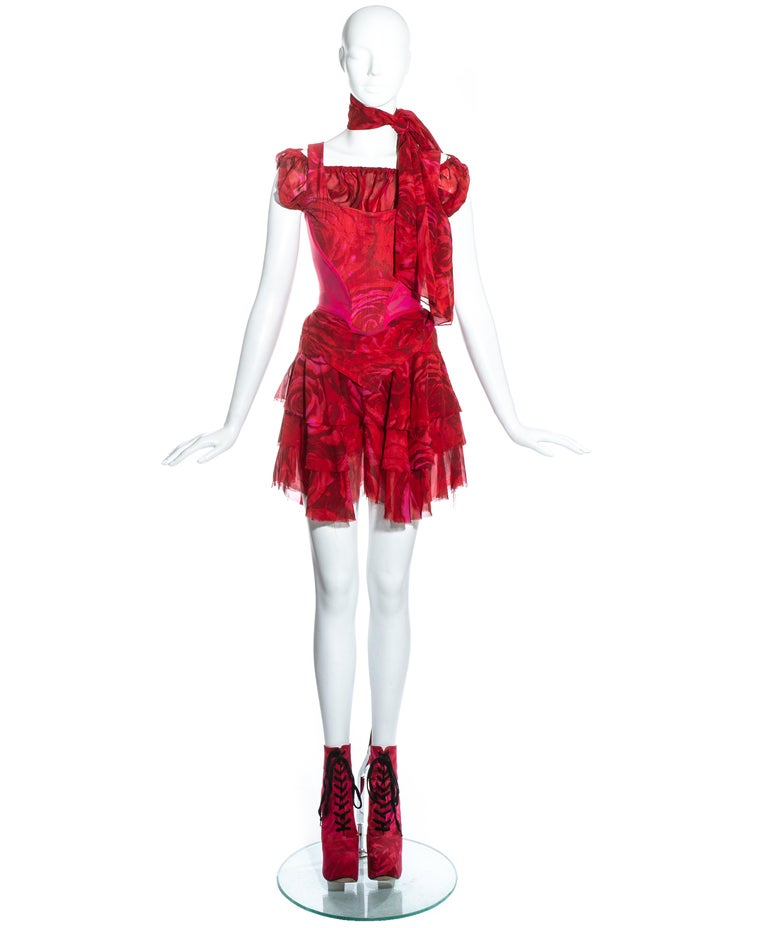 Vivienne Westwood red rose print 4 piece ensemble. Includes elevated cotton lace up platform boots (UK 6 - EU 39), layered chiffon mini skirt, chiffon blouse with elastic collar, corset with internal boning, and chiffon neck scarf.   Spring-Summer