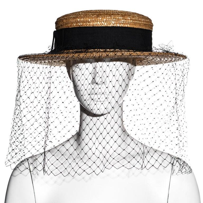 ▪ Vivienne Westwood raffia boater hat  ▪ Black grosgrain ribbon with bow ▪ Black fishnet veil  ▪ Size Medium ▪ Spring-Summer 1988
