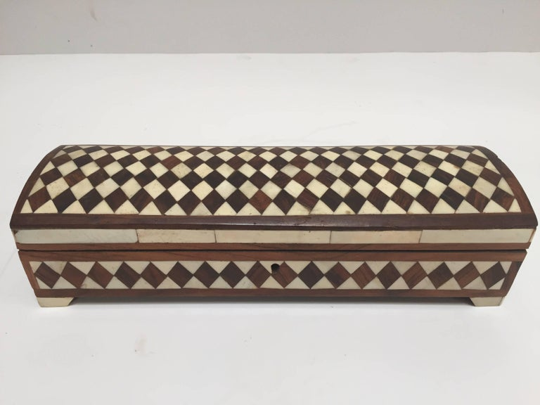 Fabulous Anglo-Indian decorative box inlaid with bone and sandalwood. Made in Vizagapatam, situated on the south east coast of India, near Madras. Sandalwood, bone horn inlaid surround the dome top and base. These exotic box pieces were crafted with