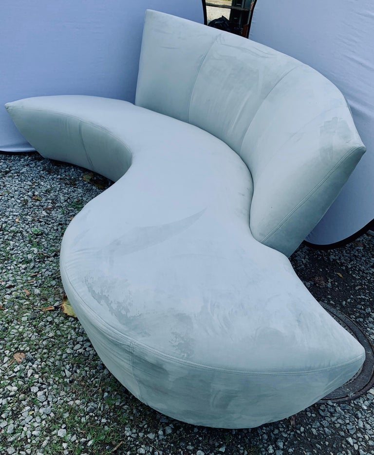A sculptural Mid-Century Modern style sofa designed by Vladimir Kagan and inspired by the curves and undulations of the Guggenheim Museum in Bilbao, Spain. It was newly reupholstered last year and is stunning. Rare to see a serpentine Kagan sofa in