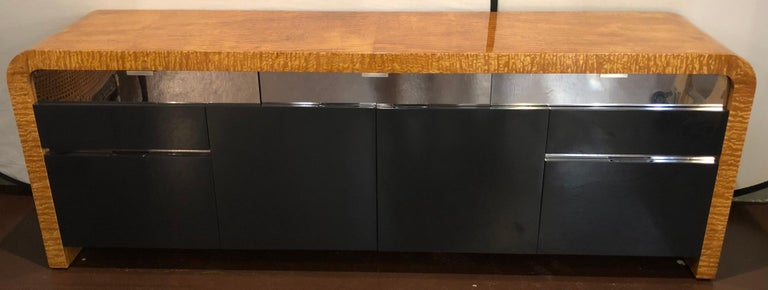 Vladimir Kagan burl wood and lacquered sideboard or console with 2 file cabinet drawers having interior locks. The two center shelved doors flanked by a pair of file cabinets on the bottom and upper drawers all in a grayish black lacquered finish.