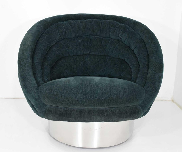 Beautiful and comfortable chair by Vladimir Kagan. Chair swivels and is currently on casters that can be easily removed. We recommend new upholstery.