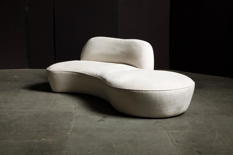 This spectacular example of Vladimir Kagan design was produced by American Leather for a short time, circa early 2000's, in its original white Alcantara Ultrasuede, signed underneath with original American Leather label. Modeled after the early