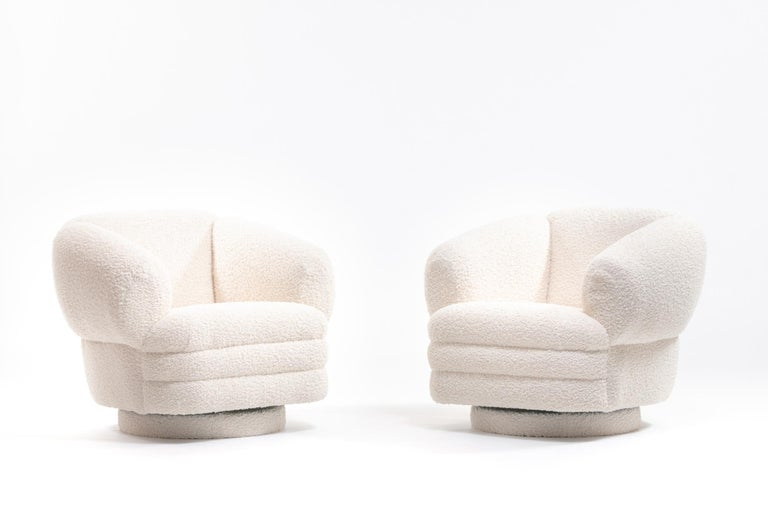 Postmodern pair of Vladimir Kagan chairs for Directional with swivel and tilt features in Ivory Bouclé. Vladimir Kagan surely understood and celebrated those iconic curves. And this robust pair is his Postmodern throne. Sculptural, Space Age, post