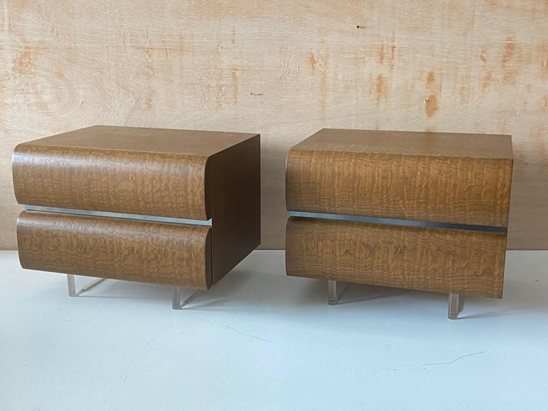 A pair of nightstands / bedside cabinets. Designed by Vladimir Kagan. Produced by Vladimir Kagan Inc. Marked with manufacturers plaque reading