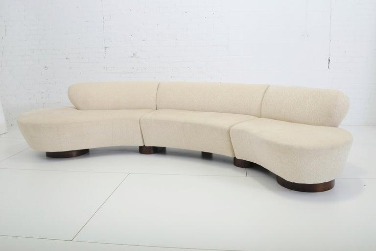 Three-piece sectional sofa designed by Vladimir Kagan for Directional. Original fabric on walnut bases.