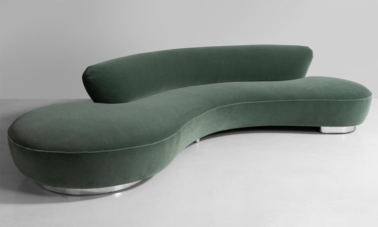 Vladimir Kagan Serpentine sofa, America, 20th century.  Large scale, chrome base, newly reupholstered in Maharam Mohair Supreme. From the New York collection.