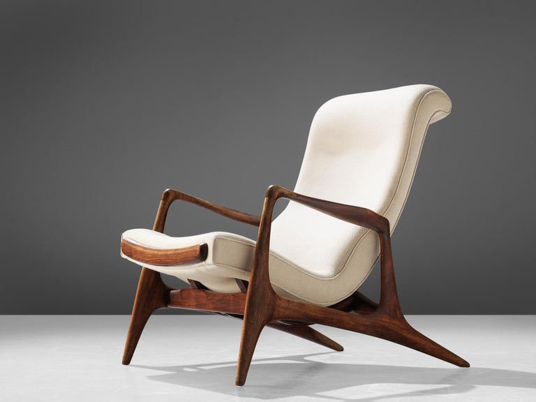 Vladimir Kagan for Dreyfuss, 'Contour' chair, teak and ivory fabric, United States, 1950s.  This lounge chair by Kagan is sculptural and delicate. The frame, executed in teak and carved and detailed in an exquisite manner. The back legs are long