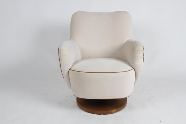 """Vladimir Kagan barrel lounge chair model 100-S with tilt and walnut wood base. It was reupholstered in 2017 using Great Plains [Holly Hunt] """"Next Generation – Winter White"""" [1607/01], which is 50% wool, 30% alpaca, and 20% silk. The contrast leather"""