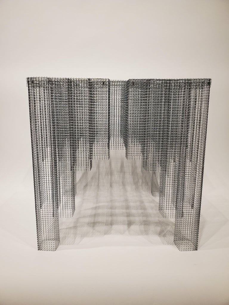 Voukenas Petrides Blur table Zinc-coated wire mesh, 2019  Voukenas Petrides is a design studio based in New York and Athens. Furniture designer Andreas Voukenas and architect Steven Petrides combine their talents to produce poetic furniture