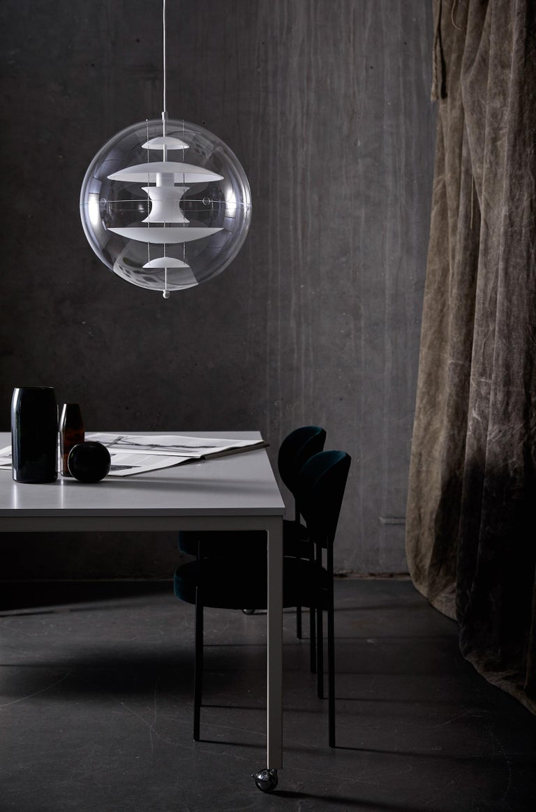 Pendant made of transparent acrylic. Five reflectors inside. Suspended by three steel chains. Includes ceiling canopy.    Material: Reflectors are made of hand blown opal white glass. Ceiling canopy is made of metal (white lacquered). Light source: