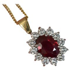VS1 1.00 Carat Diamond 2.2 Carat Ruby 18 Carat Gold Pendant Chain