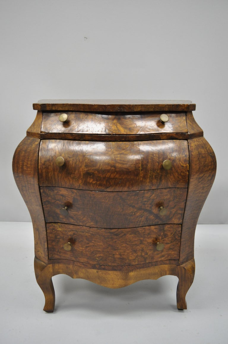 Vintage miniature Italian burl olive wood French Louis XV style bombe chest. Item features shapely bombe form,