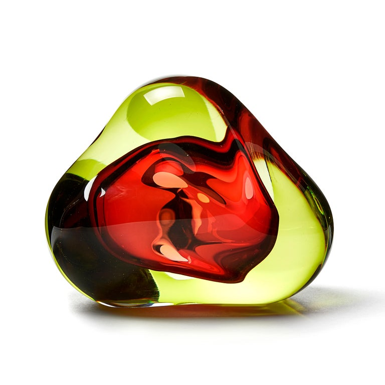 Vug in Lime and Fuschia is a unique hand blown sculpture by the British artist Samantha Donaldson. Created by layers of coloured glass in lime green and vibrant pink, the transparent colours merge and create further hues throughout the piece. An