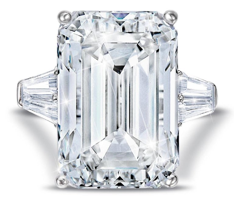 This exquisite ring  features a GIA Certified 3.50 carat Emerald cut diamond of F color and VS1 Clarity. Flanked by a pair of tapered baguettes = approximately 0.50 ctw set in a platinum mounting, this ring will forever remain a classic and elegant