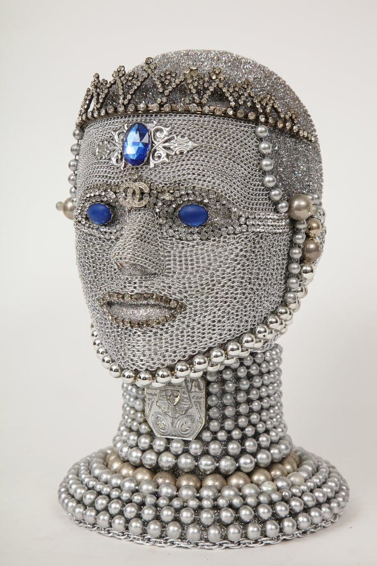 Futuristic android bust with hand applied chain mail and vintage jewelry findings and tiara from New York artist W. Beaupre. Signed.