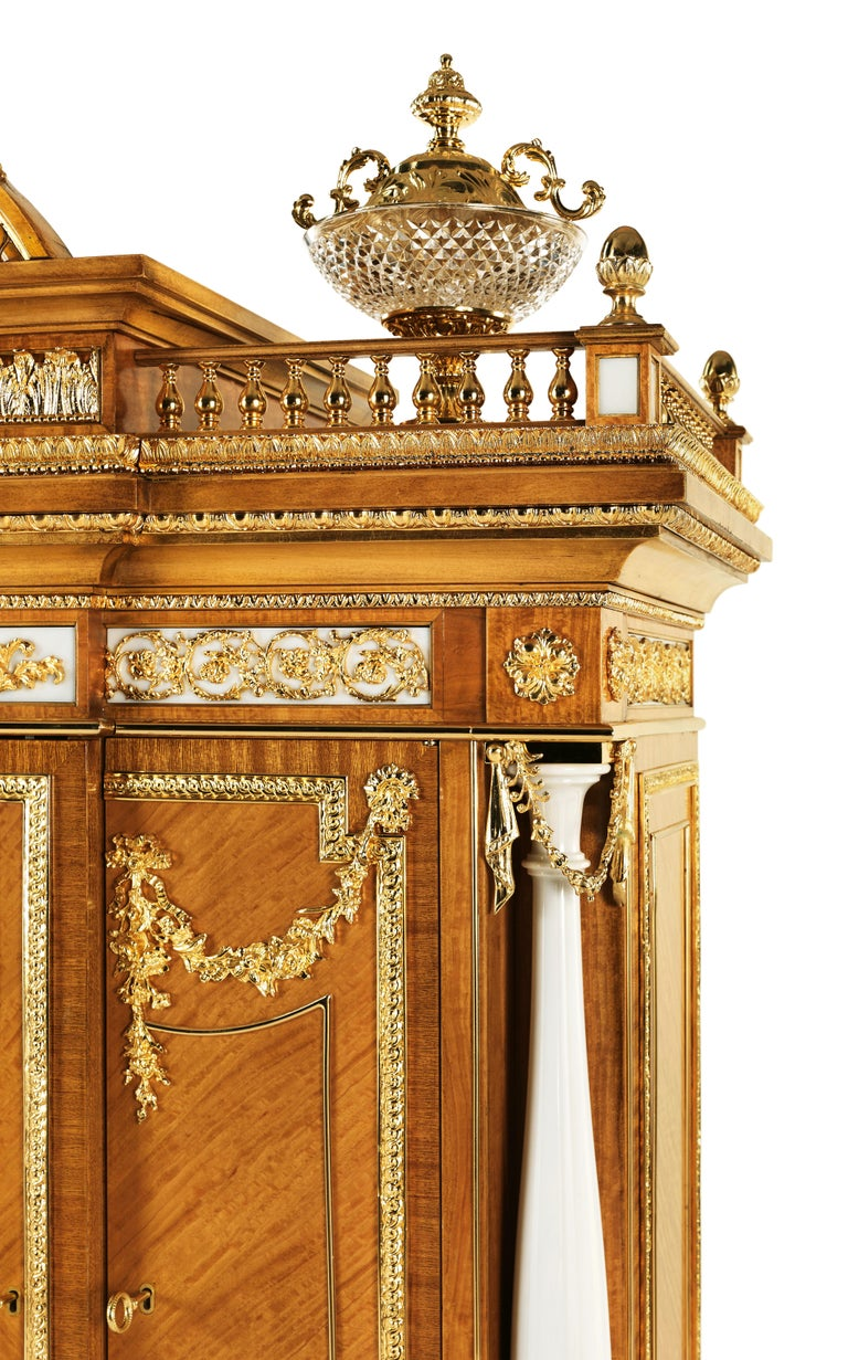 "W029 is a masterpiece cabinet in citronnier, with 46 marble ""Bianco B"" elements, crystal bowls, 70 Kg of brass details finishing gold 24 Kts, bas-relief in marble, inlaid in mother of pearl inside.  Please Note:  - If the item is to be shipped to"