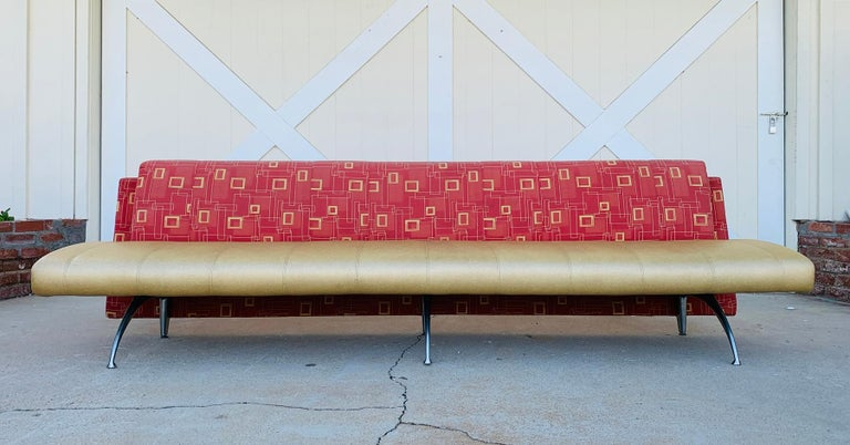 Stunning sofa made in Italy, designed by Rodolfo Dordoni and manufactured by Moroso.  The sofa has beautiful architectural lines, the legs are made of aluminum, the seat is upholstered in a brown vinyl and the back is a reddish fabric.  The sofa