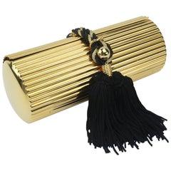 Walborg Gold Metal Cylinder Handbag With Black Tassel Closure