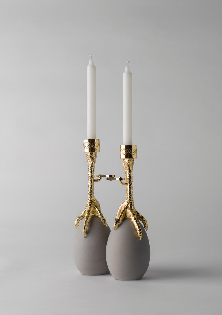 Walking hen gold plated candleholder by Aisha Al Sowaidi Limited edition 8 pieces + 2 prototypes + 2 A.P. Dimensions: 21 x 30 x 7 cm Materials: Claws in cast brass and hinges in steel - both in a 24 carat gold plated finish. Eggs in