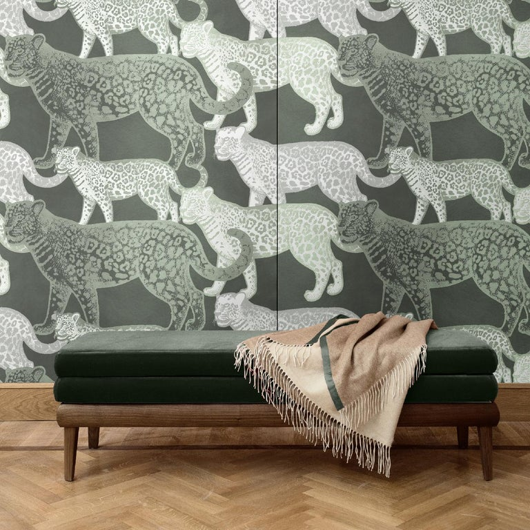 A mesmerizing combination of contrasting colors and naturalistic style creates this bold and sophisticated wall covering, depicting walking leopards of two different sizes. A dream-like scene that will make a statement in any modern interior, this