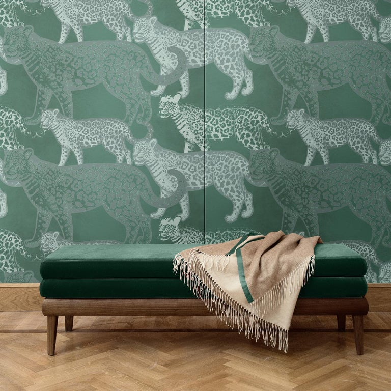 Alternating three different versions of leopards, finely depicted as they walk over a dark background, this wall covering is a bold and sophisticated choice for a modern interior. Its mesmerizing quality will make a statement in any room in the
