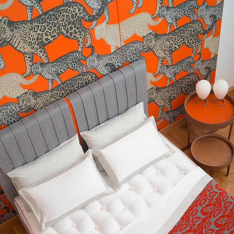 This superb wall covering is part of the Walking Leopards collection, distinctive for the juxtaposition of naturalistically rendered animals in three different color combinations. The grey and orange hues are both sophisticated and bold for a