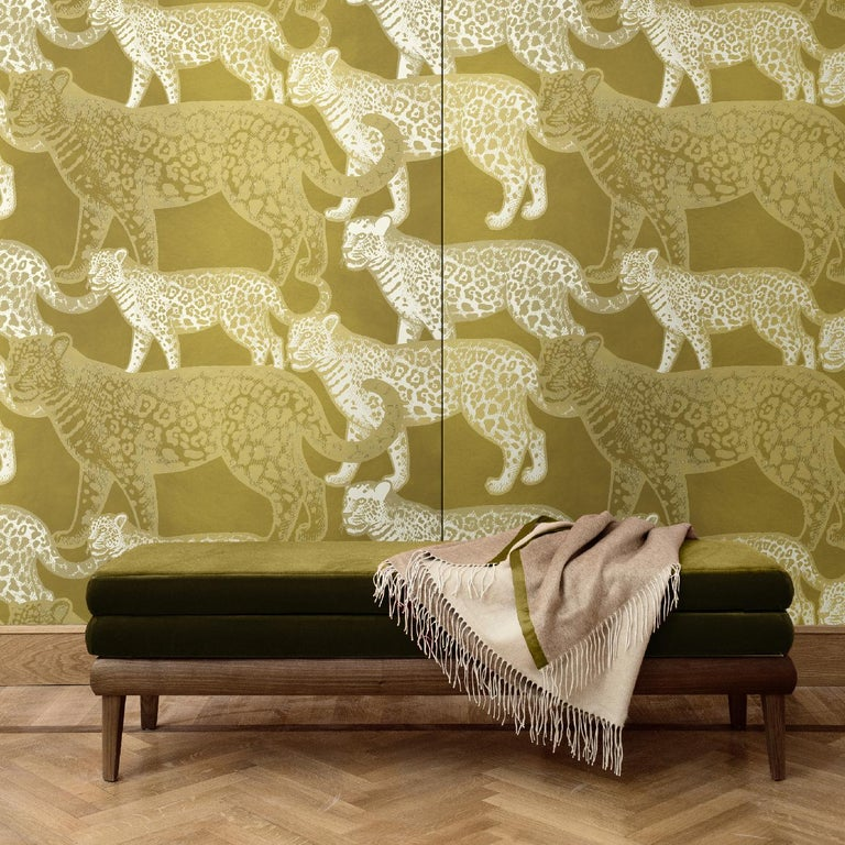 Part of the Walking Leopards collection, this wall covering is a bold and elegant choice for a modern interior. It will make a statement in an entryway, study, or powder room, where the combination of warm colors and the mesmerizing scene depicted